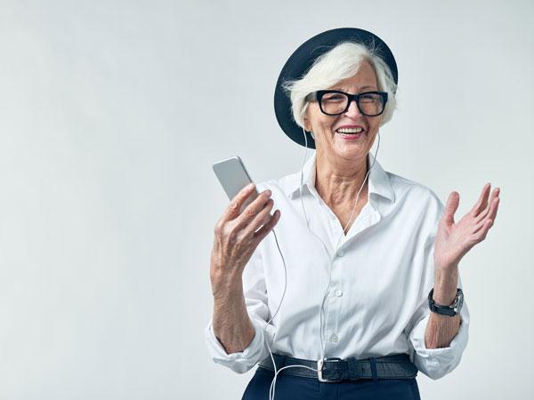 Senior using cell phone and social media